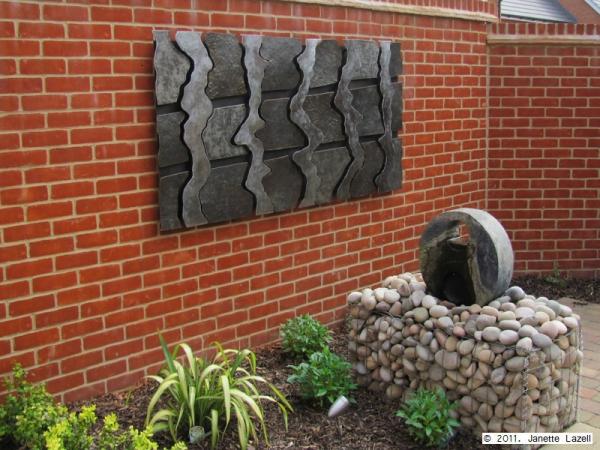Sculpture-wall hanging in garden-view 1
